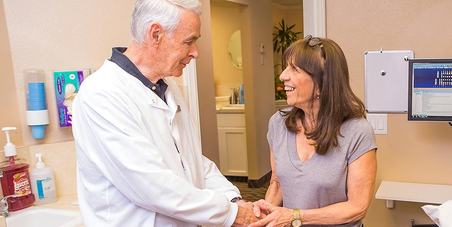 Dentist greeting new patient